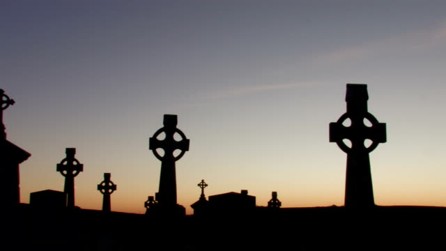Celtic crosses in graveyard at dawn video