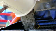 Cement Mixer Unloading Concrete on Construction Site CU video