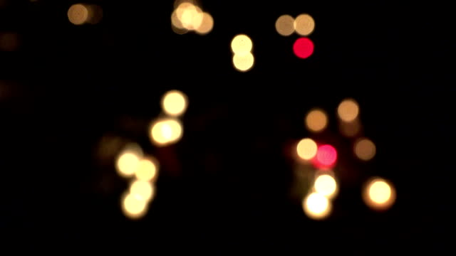 cemetery decorated with candles for All Saints Day at night. blur in. FullHD video