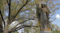 Cemetery Statue on a Spring Day video