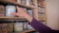 Ceramic maker selecting colors and enamels in plastic jars video