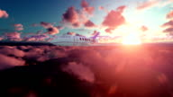 Cessna airplane above clouds at sunset video