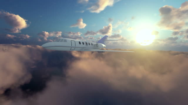 Cessna airplane flying above clouds at sunrise video