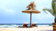 Chair`s and parasol on the beach video