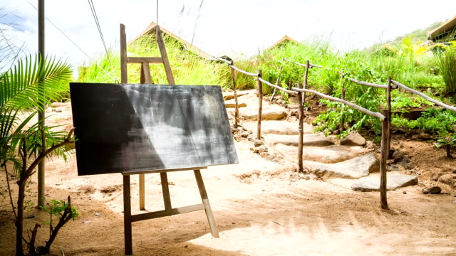 chalk board at tropical island with nature background video