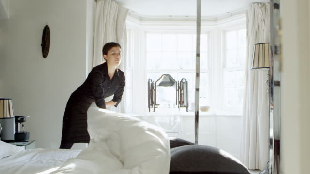 Chambermaid Making Bed In Boutique Hotel Shot On R3D video