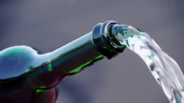 Champagne bottle pouring water video