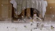 Chandelier falling and breaking on wooden floor . Slow Motion. video