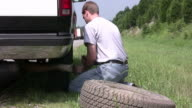 Changing a flat tire video