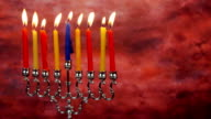 Chanukah candles all in a row. Bright, shiny multicolor candles for the Jewish holiday video
