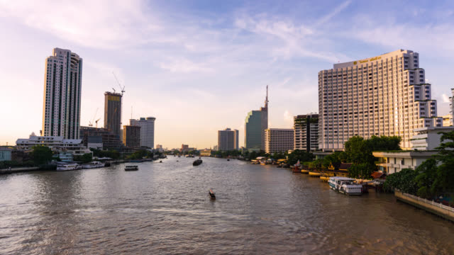 Chao phraya river view in the sunset, travel by passenger ship the waterways of Bangkok Thailand video