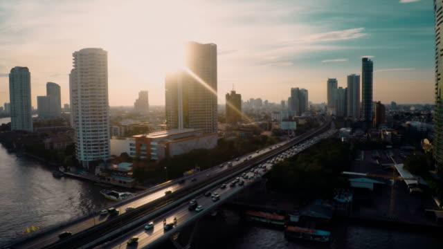 Chao Phraya riverside sunset Aerial video