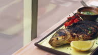 Chargrilled fish, tomatoes and dressing, pan video