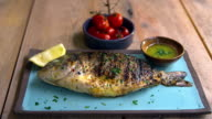Chargrilled whole fish, roasted tomatoes and dressing, zoom video