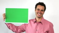 Charismatic Sales Guy With Green Screen Board, Laughing video