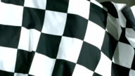 Checkered flag waving in wind, slow motion video