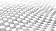 Checkered surface of white cubes waving. Loopable 3D animation video