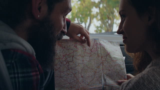 Checking a map in a car video