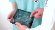 Checking ultrasound on digital tablet video