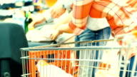 Checkout at cash register in supermarket. video
