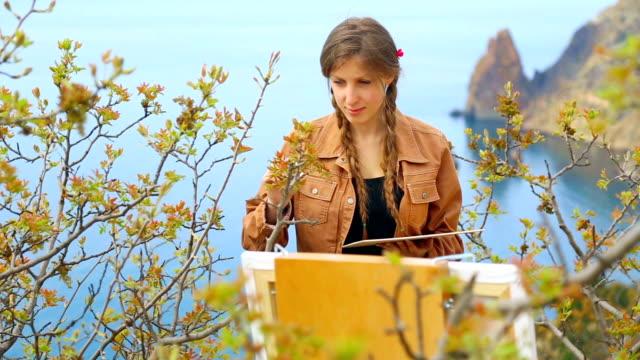 cheerful artist on the beautiful wild coast video