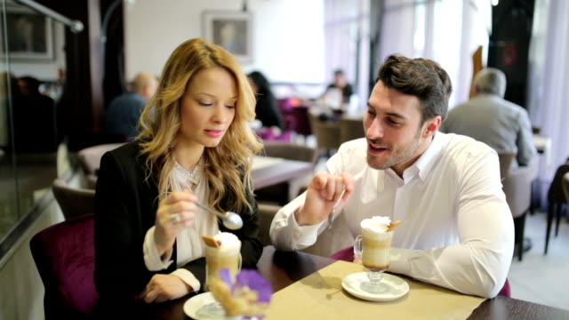 Cheerful couple enjoying in the  cafe video