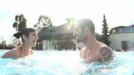 HD SUPER SLOW-MO: Cheerful Couple In The Pool video