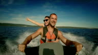POV Cheerful Couple On A Jet Boat video