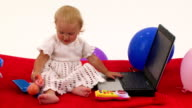 Cheerful Cute Little Girl Playing With Toys video