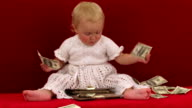 Cheerful Cute Little Girl Playing With Wallet Full Of Dollars video