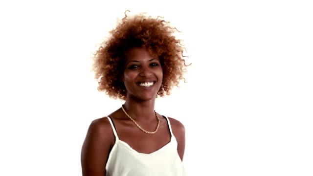 Cheerful Ethiopian girl gives hush sign video