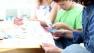 HD: Cheerful Family Cutting Shopping Coupons. video