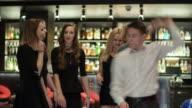 Cheerful friends dancing in nightclub video