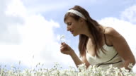 SLOW MOTION: Cheerful girl smelling white flower video