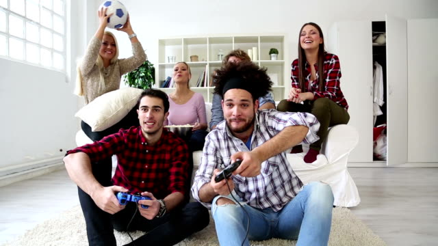 Cheerful Group Of Young Friends Playing Video Games video