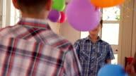 Cheerful Hispanic Boy Playing With Balloon And Having Fun video