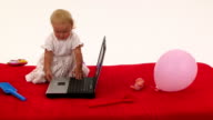 Cheerful Little Girl Playing With Laptop video