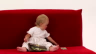 Cheerful Little Girl Playing With Wallet Full Of Dollars video