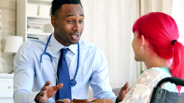 Cheerful male doctor discusses female patient's test results video