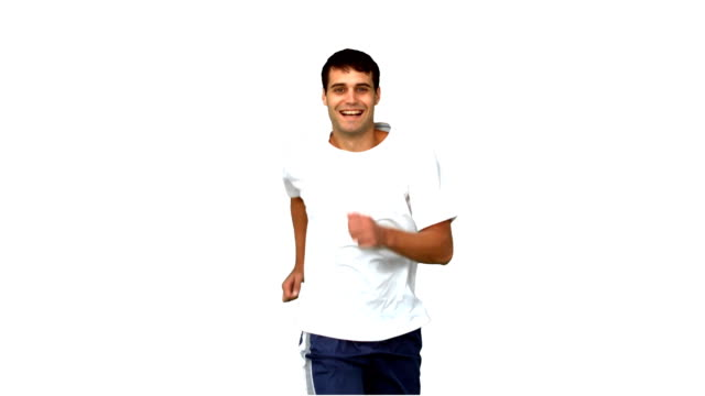 Cheerful man jogging on white screen video