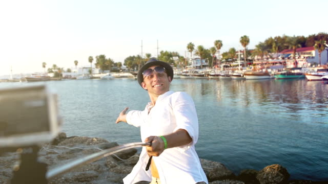 Cheerful man taking selfie on the Side bay background in Turkey video