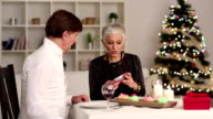 Cheerful mature couple have Christmas dinner video