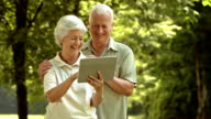 HD: Cheerful Seniors Using A Digital Tablet video