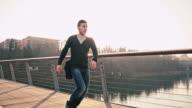 WS TS Cheerful Student Crossing The Bridge video