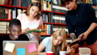 Cheerful students in library video