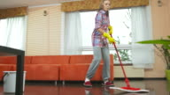 HD DOLLY: Cheerful Teenage Girl Mopping The Floor video