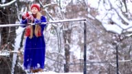 Cheerful woman drinking mulled wine in winter video