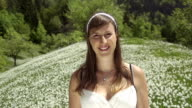 SLOW MOTION: Cheerful woman in a flower field video