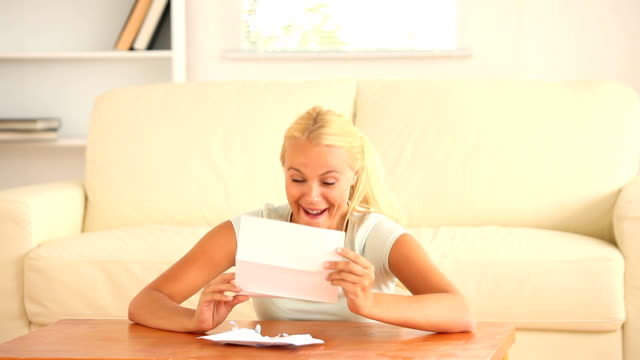 Cheerful woman receiving a mail video