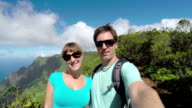 SELFIE: Cheerful young couple on reached the top of the mountain in Hawaii video